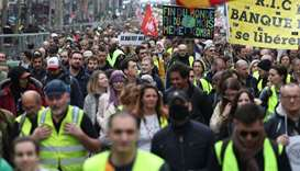 Yellow Vest protesters take part in an anti-government demonstration called by the 'Yellow Vest' (gi
