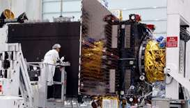 Technicians work on the Inmarsat S-Band/Hellas-Sat 3 satellite