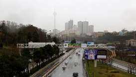 drivers on a wet road during a rainy day in the Iranian capital Tehran