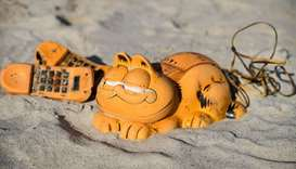 Spare parts of plastic 'Garfield' phones are displayed on the beach in Plouarzel, western France