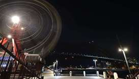 The Sydney Harbour Bridge, the Opera House and the ferris wheel are seen after their lights went out