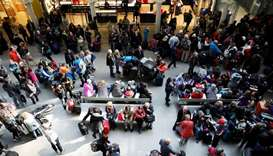 People wait due to Eurostar delays at St Pancras Railway Station in London, Britain