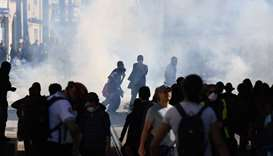 Protesters are seen among tear gas smoke during clashes with police at a demonstration as part of a