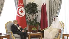 His Highness the Amir Sheikh Tamim bin Hamad al-Thani and Tunisian President Beji Caid Essebsi holdi