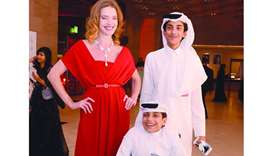 Russian supermodel and philanthropist Natalia Vodianova with popular young local hero Ghanim al-Muft