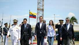 Venezuelan opposition leader and self-proclaimed acting president Juan Guaido (C) and his wife Fabia