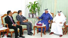 Qatar Chamber first vice-chairman Mohamed bin Towar al-Kuwari welcomes (from left) Trade commissione