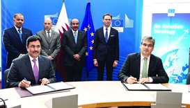 HE al-Subaey and Carlos Acosta signing Qatar, EU air transport agreement as HE al-Sulaiti, HE al-Bak