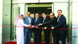 Top officials of Mannai Trading and General Motors led the ribbon-cutting ceremony of the new state-