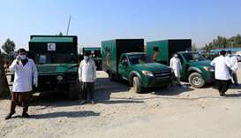 Ambulances are parked while waiting to transfer the wounded near the site of an attack in Jalalabad