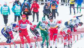 Alexander Bolshunov (Front) of Russia competes during the mens's 50 km C Mst event at the FIS Cross