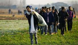 Migrants walk towards the Turkey's Pazarkule border crossing with Greece's Kastanies, near Edirne, T