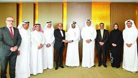 Doha Bank CEO Dr R Seetharaman and QDB CEO Abdulaziz bin Nasser al-Khalifa with the 'Best Partner Ba