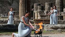 Olympic flame lit in Greece in front of limited crowd