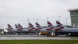 The tail fins of parked British Airways planes are seen near Terminal 5 at Heathrow Airport in Londo