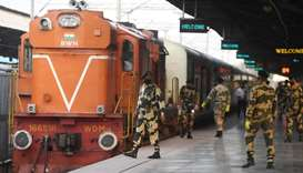 Indian security personnel wearing facemasks amid concerns over the spread of the COVID-19 novel coro