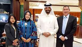 QIBC president Farhan al-Sayed (centre) joins Fujie Wati and Lisa Kohar Abdullah during a visit of A