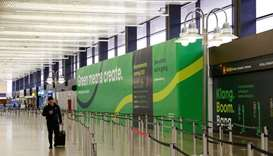 A traveler walks past empty security lines at Seattle-Tacoma International Airport,