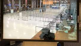 A screen shows the arrival hall at the inmigration area at 8:20pm Saturday night at Suvarnabhumi int