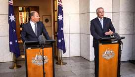 Australian Prime Minister Scott Morrison (R) speaks as he stands with the Australian Treasurer Josh