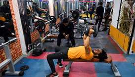 A patron exercises in a gym in New Delhi
