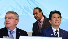 International Olympic Committee (IOC) President Thomas Bach (L), Japan's Prime Minister Shinzo Abe (