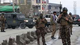 Afghan security personnel stand guard near the site of an attack to a Sikh temple in Kabul