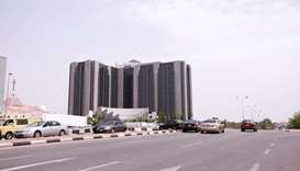 Some cars drive past the Central Bank of Nigeria headquaters in Abuja, Nigeria