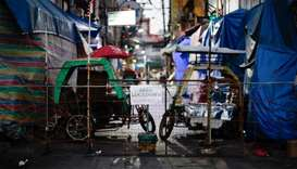 Makeshift barricades block some streets to contain the coronavirus disease (COVID-19) in Manila