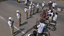 Members of traffic police fold their hands as they request the commuter to wear masks and to stay at