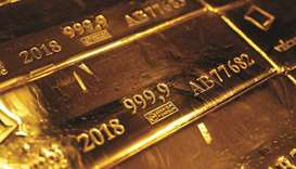 A mark of 999.9 fine sits on hallmarked 12.5 kilogramme gold bullion bars stacked at the Valcambi pr