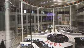 Employees work on the trading floor of the Tokyo Stock Exchange. The Nikkei 225 closed up 3.9% to 19