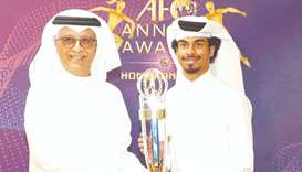 In this December 10, 2019, picture, Qatar's Akram Afif (right, also left) receives the AFC Player of