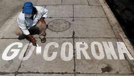 A man paints a message on a street in Mumbai yesterday.