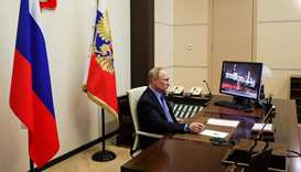 Russian President Vladimir Putin attends a meeting with regional officials via tele link in his resi