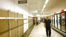 Shelves are empty of toilet rolls in a supermarket in Sydney