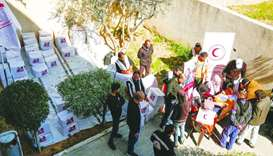 QRCS provides food, winterisation aid for 2,815 families in Palestine