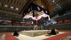 Spectator's seats are seen empty during a match of the Spring Grand Sumo Tournament which is taking