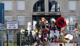 Sprays of flowers are seen on a fence of closed College Jean de la Fontaine after the death of a tea