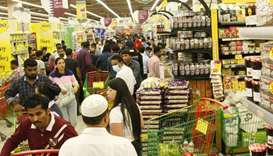 Residents shopping for necessities at a Doha store Monday