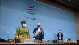 New Director-General of the World Trade Organisation Ngozi Okonjo-Iweala (L) stands prior to a sessi