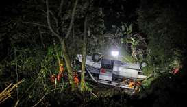 Rescue personnel work at the crash site after a bus fell into a ravine in Sumedang, West Java Provin