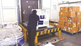 IMPRESSIVE: An airport staff unloads a carton box of Covishield vaccine developed by Pune based Seru
