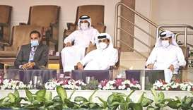His Highness the Amir Sheikh Tamim bin Hamad al-Thani watches the match between Spain's Garbine Mugu