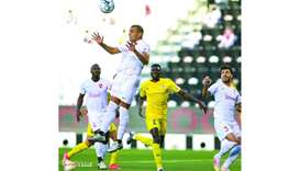 Action from the match between the Ooredoo Cup match between Al Rayyan (in white) and Al Gharafa (in