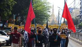 Protesters carrying flags of the National League for Democracy (NLD) party, during a demonstration a