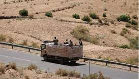 Troops in Eritrean uniforms are seen on top of a truck near the town of Adigrat, Ethiopia, March 14,
