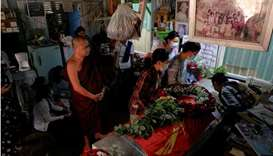 People attend the funeral of Kyaw Win Maung, who was shot and killed during a protest against the mi
