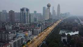 An aerial view taken on January 27, 2020 shows residential and commercial buildings of Wuhan in Chin
