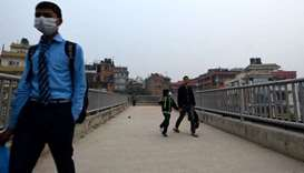 Students walk back to their homes amid smoggy conditions in Kathmandu on March 29, 2021